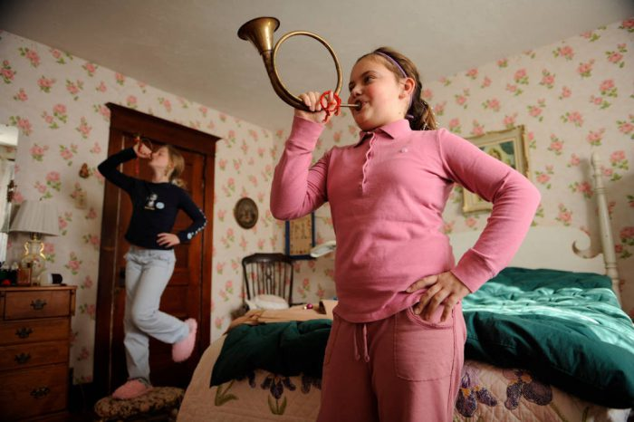 Photo: Two girls play brass instruments during the holidays.