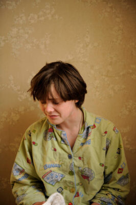 Photo: A 13-year-old-boy cries in his pajamas.
