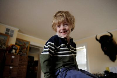 Photo: A 4-year-old boy laughs in his father's office.