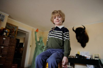 Photo: A 4-year-old boy stands up tall in his father's office.