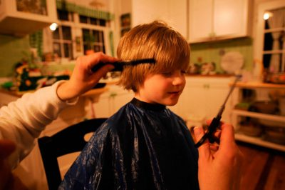 Photo: A 4-year-old boy gets his haircut at his home in Lincoln, NE.