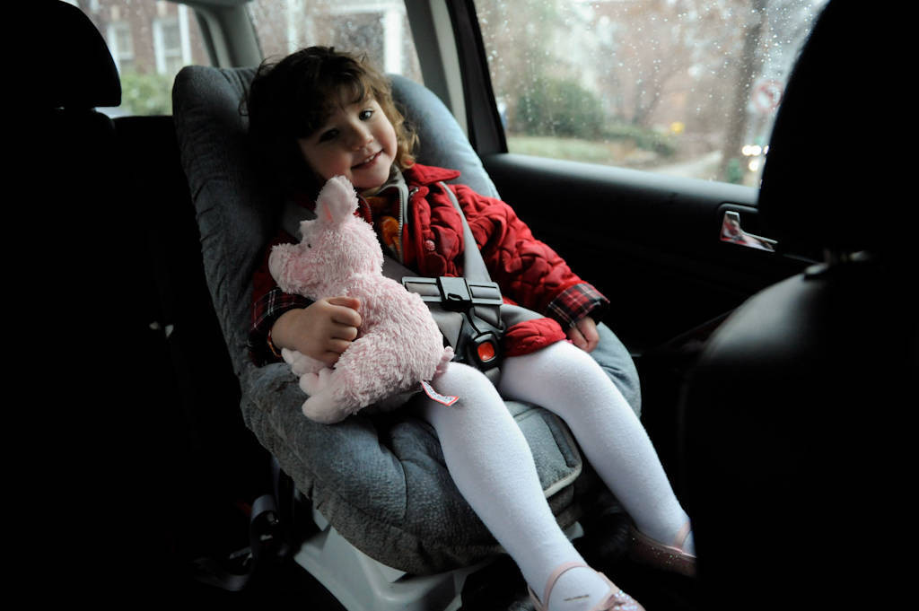 Photo: A young girl rides in her carseat.