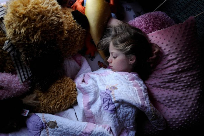 Photo: An 11-year-old girl takes a nap.