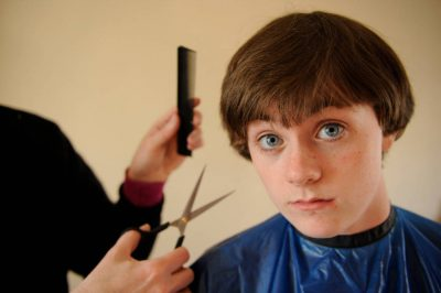 Photo: A teenage looks uncertain about getting his hair cut.