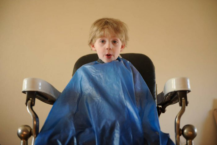 Photo: A 4-year-old boy waits patiently for a haircut.