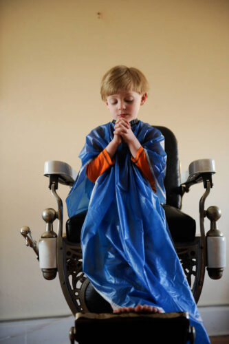 Photo: A 4-year-old boy says a prayer.