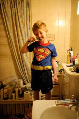 Photo: A boy brushes his teeth.