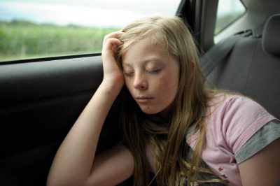 Photo: A girl sleeps during a car ride.