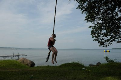 Photo: A girl swings along the shore of Leech Lake near Walker, MN.