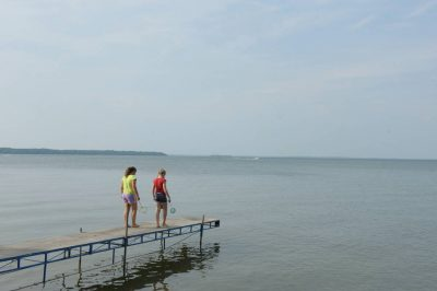 Photo: Two girls play play along a dock on Leech Lake near Walker, MN.