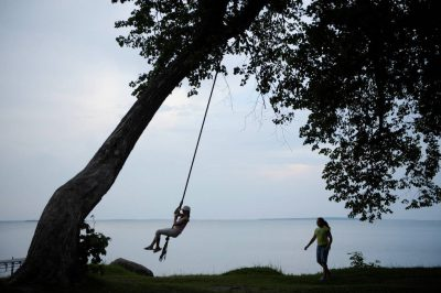 Photo: Two girls play along the shore of Leech Lake near Walker, MN.