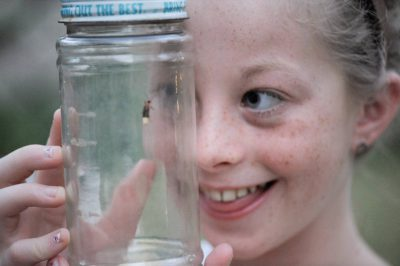 Photo: A girl with fireflies that she caught at her home in Lincoln, NE.