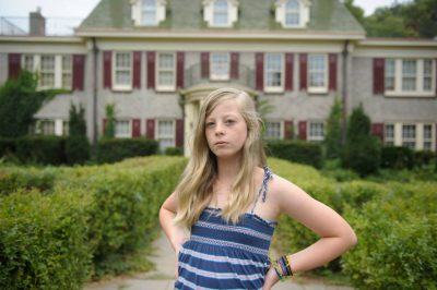 Photo: A girl in front of her home in Lincoln.