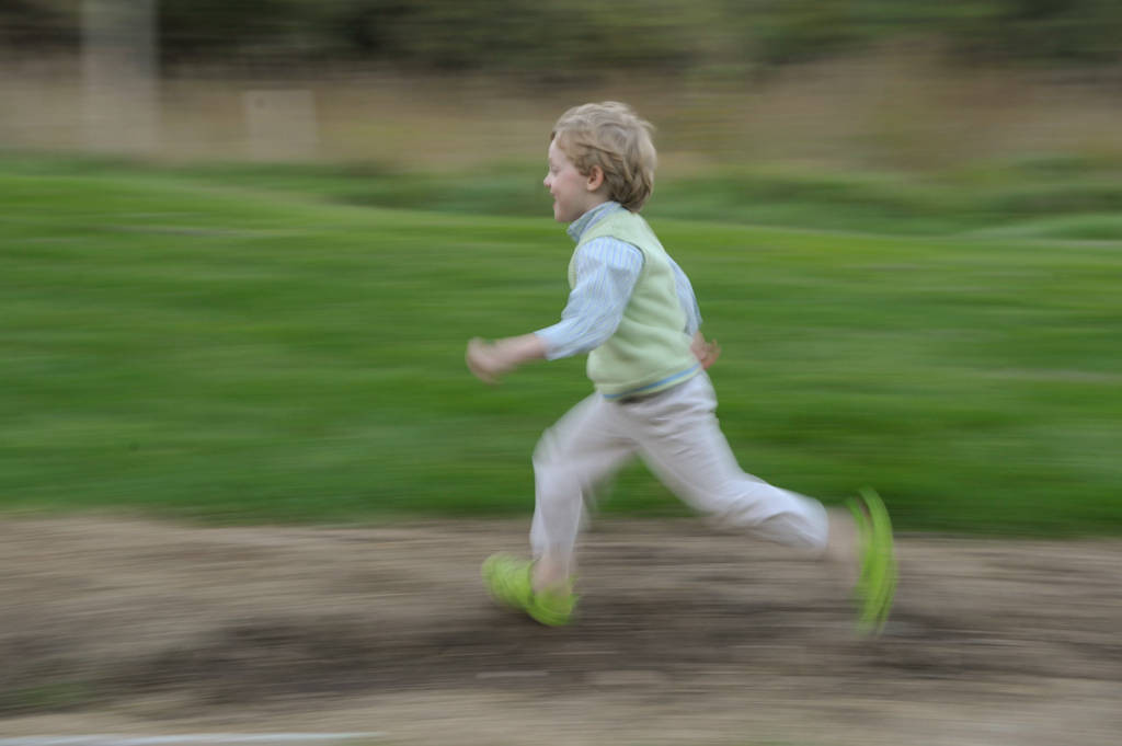 Photo: A boy runs and plays at Mahoney State Park near Ashland, NE.