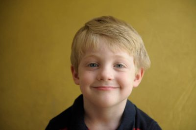 Photo: Portrait of a four year-old boy.