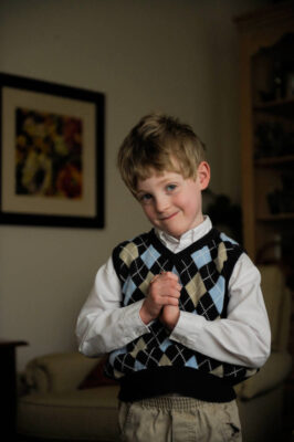 Photo: Portrait of a five year-old boy.
