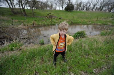 Photo: A young boy frowns on a nature walk near Dunbar, NE.