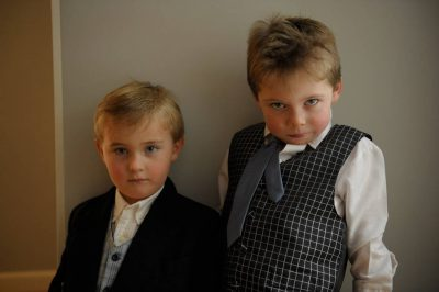 Photo: Portrait of two boys in dress clothes.
