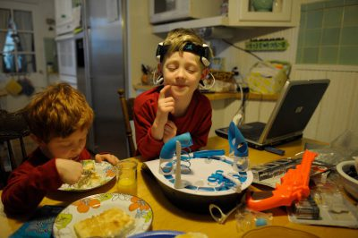 Photo: Two boys at the kitchen table in a Nebraska home.