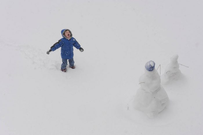 Photo: A boy plays in the snow in Nebraska.
