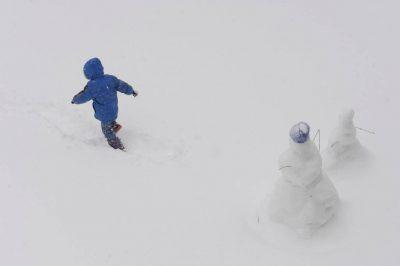 Photo: A boy plays in the snow in Nebraska.