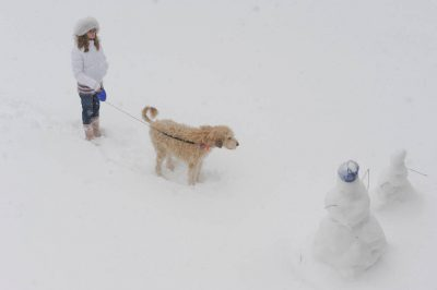 Photo: A girl and her dog in the snow in Nebraska.