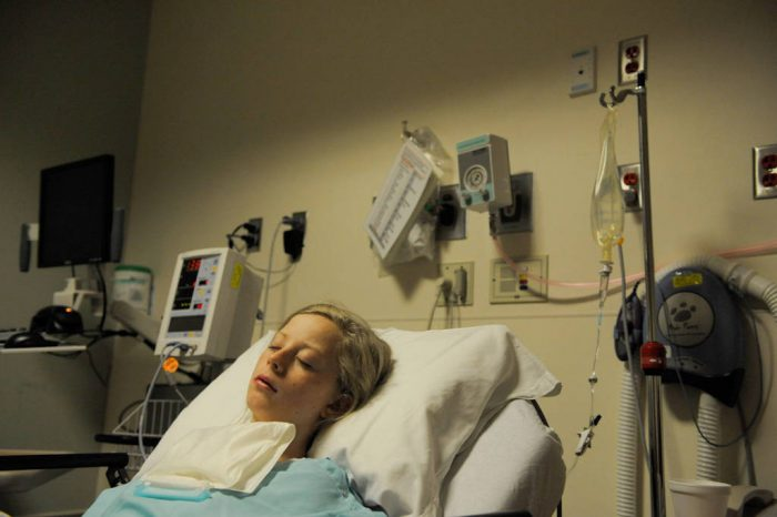 Photo: A twelve year-old girl recovers after surgery to remove her tonsils.