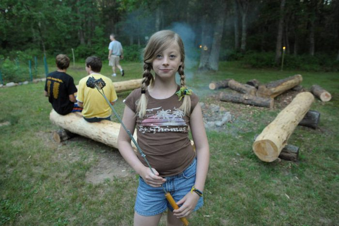 Photo: An eleven year-old girl with burned marshmallows by a campfire in Cross Lake, Minnesota.