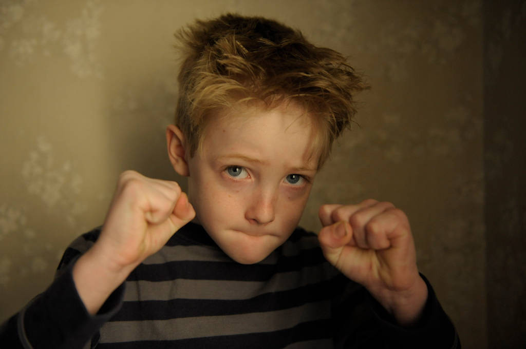 Photo: Portrait of a six year-old boy.