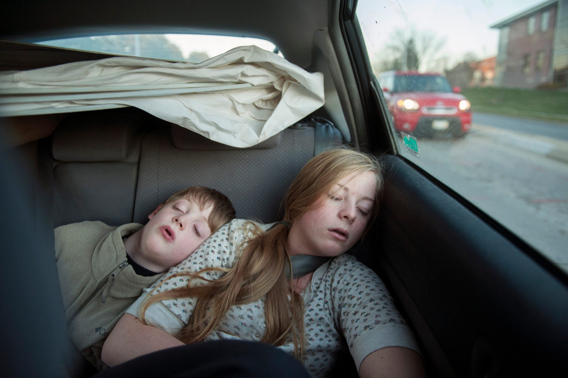 Photo: A brother and sister sleep during a car ride.