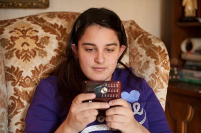 Photo: A teenage girl plays with her cell phone in Lincoln, Nebraska.
