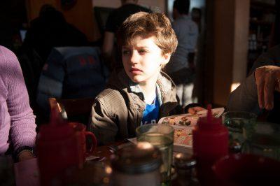 Photo: A young boy reads comics in Washington, DC.
