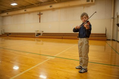 Photo: A young boy practices his violin before a talent show in Lincoln, Nebraska.