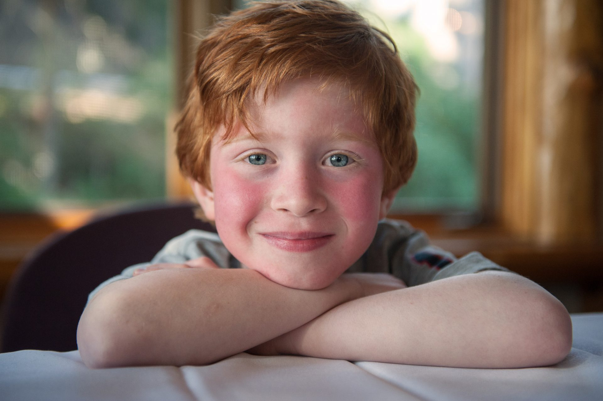 Photo: A happy, young boy with red hair.