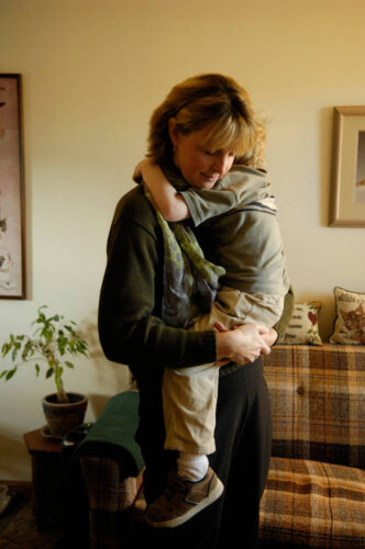 Photo: A woman holds her 4-year-old son in Hastings, NE.