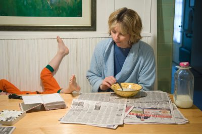 Photo: A mother eats her breakfast with her four-year-old son, who likes to wear his pumpkin Halloween costume all the time.