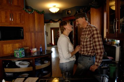 Photo: A man and his wife talk in their spotless kitchen.