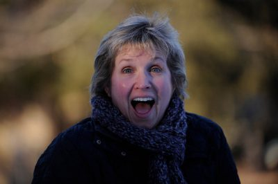 Photo: A middle-aged woman is excited.