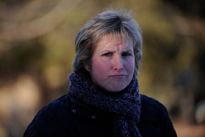 Photo: A middle-aged woman frowns.