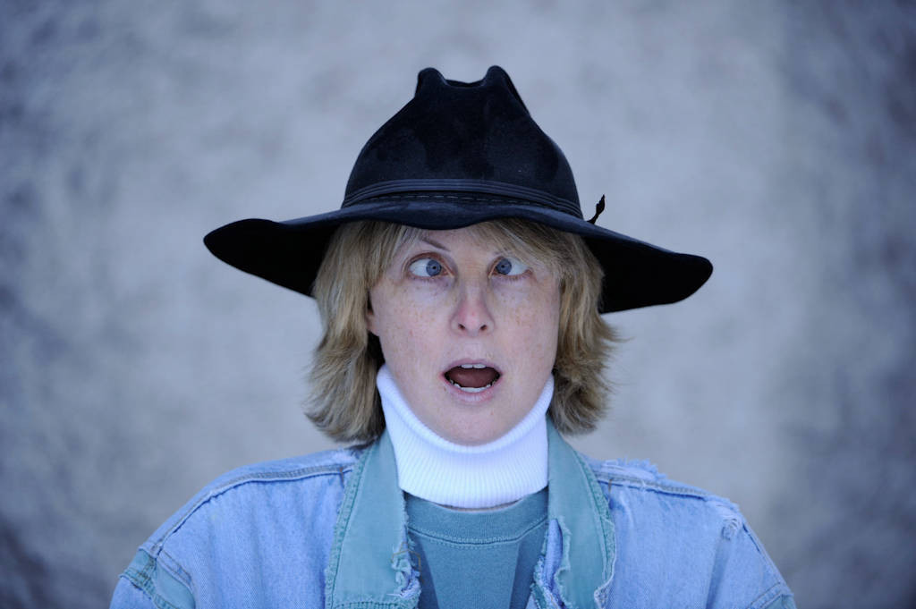 Photo: A middle-aged woman wears a cowboy hat.