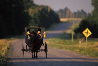 Photo: A Mennonite couple in a horse-drawn buggy near Partridge, KS.