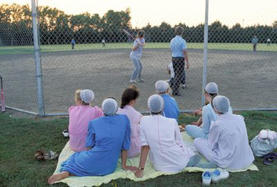 Photo: Young Mennonite women enjoy a softball game in Partridge, KS.