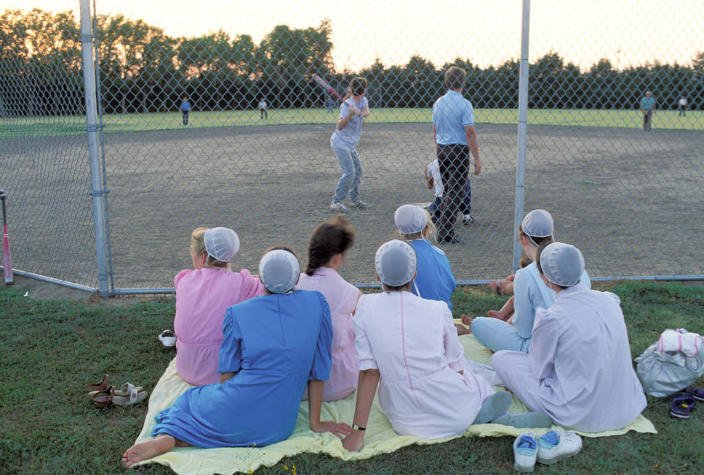 Photo: Young Mennonite women enjoy a softball game in Partridge, KS.