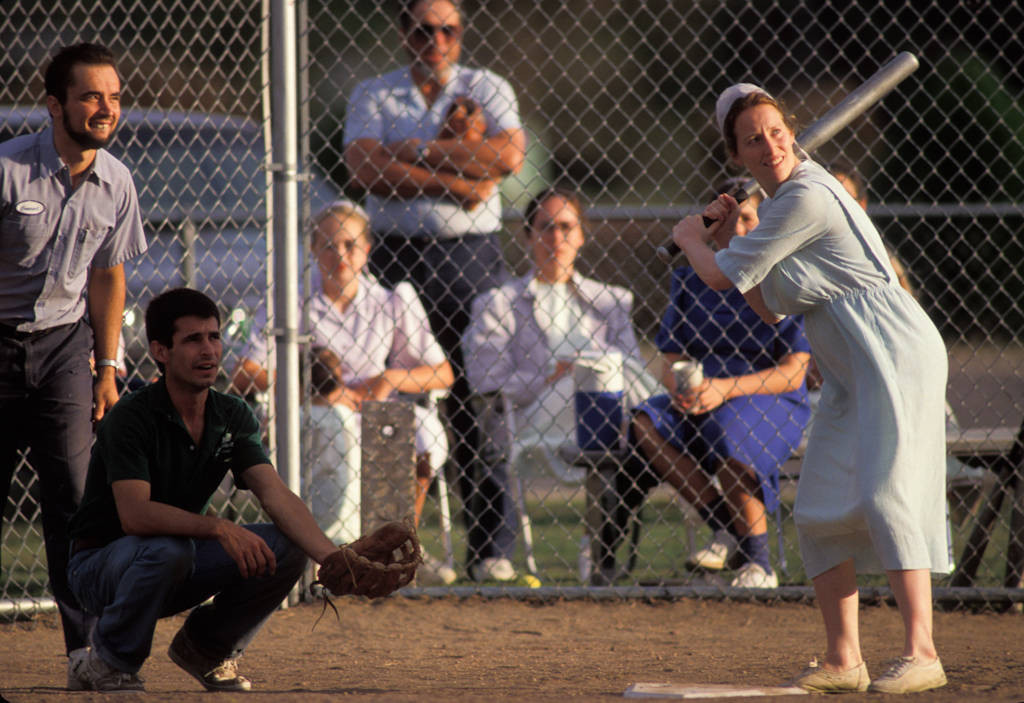 Photo: A young mennonite woman waits for a pitch during a softball game in Partridge, KS.
