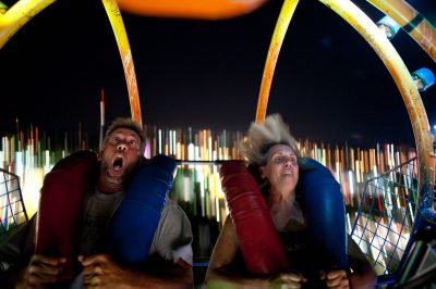 Photo: A man and woman react with surprise to the speed of the slingshot ride at the Minnesota State Fair.