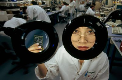 Photo: At Megahertz quality-control lab a technician scans for defects in electronic equipment.