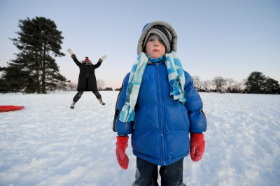 Photo: A young boy and his sister go sledding at Pioneers Park in Lincoln, Nebraska on a cold December day.