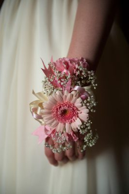 Photo: A prom corsage adorns the wrist of a teenage girl.