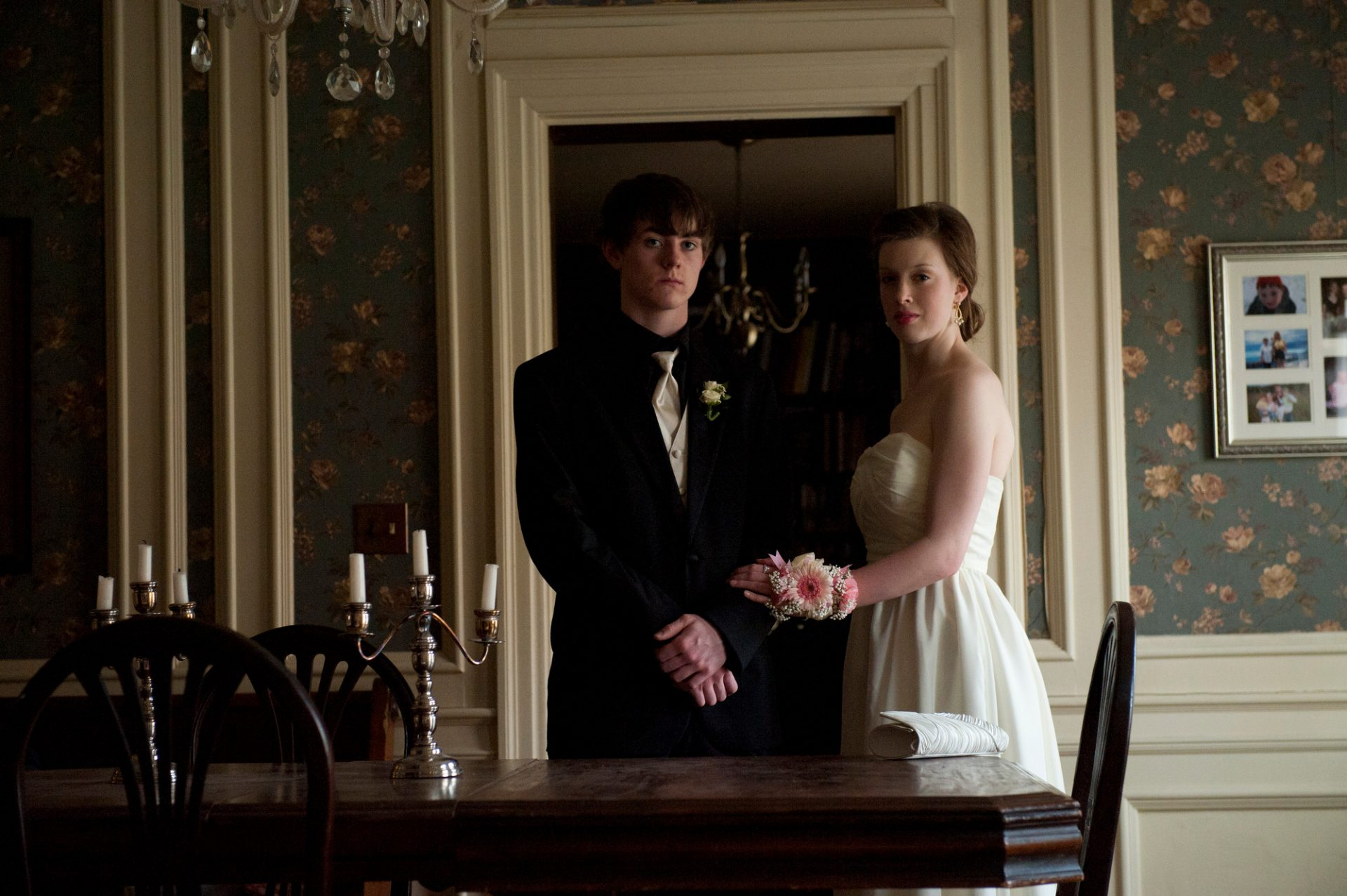 Photo: A solemn young couple readies for prom.