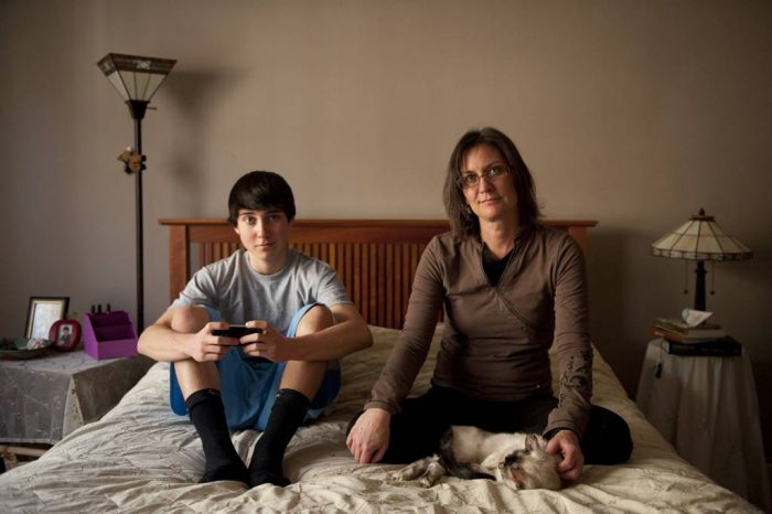 Photo: A mother and her teenage son spend time together.